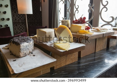 Various types of cheese in Wine room - stock photo