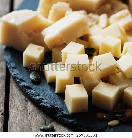 Various types of cheese on the table, selective focus and square image - stock photo