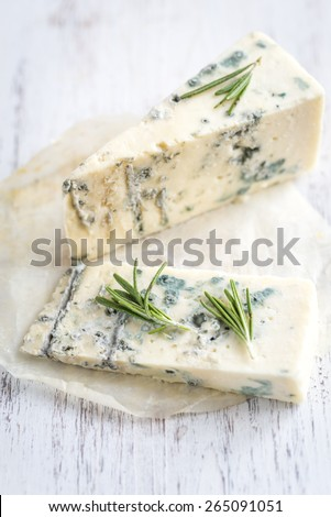 Various types of cheese on the wooden board - stock photo