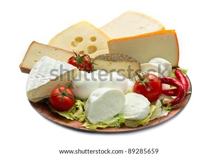 Various types of cheese on wooden board - stock photo