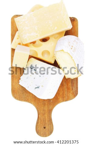 various types of cheese on wooden platter isolated on white background - stock photo