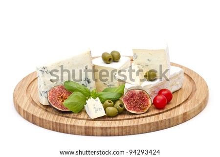 Various types of cheese on wooden platter, isolated on white background - stock photo