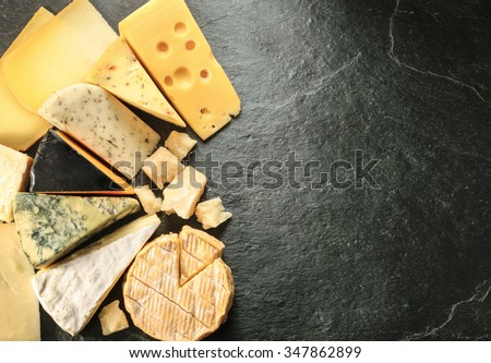 Various types of cheese with empty space background - stock photo