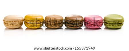 various types of macaroons on white background