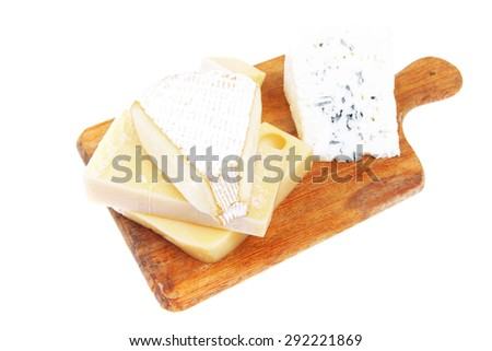 various types of solid french cheese parmesan brie and edam on wooden platter isolated on white background - stock photo