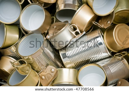 Various types of tin cans to be recycled - stock photo