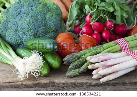 Various types of vegetables from the market on a rustic wooden background