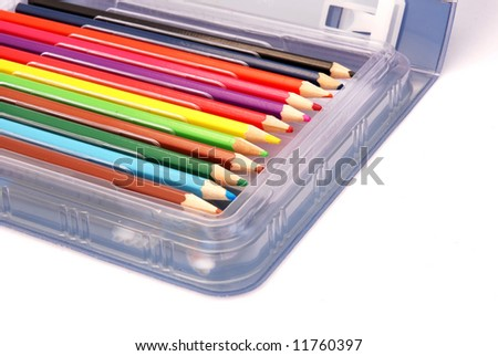Various used colorful pencils in a plastic box isolated on white background - stock photo