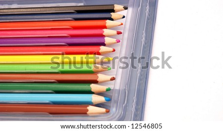 Various used colourful pencils in a plastic box isolated on white background - stock photo