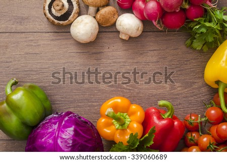 various vegetables in a circle on the floor - stock photo