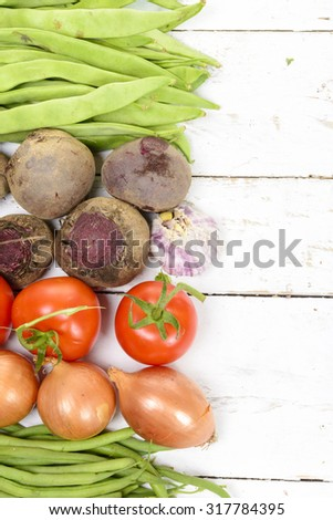 various vegetables on a white wooden table