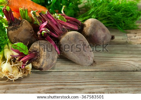 Various vegetables on a wooden table closeup. Vegetable background