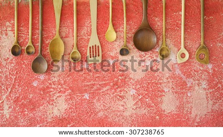 various vintage wooden kitchen utensils, free copy space