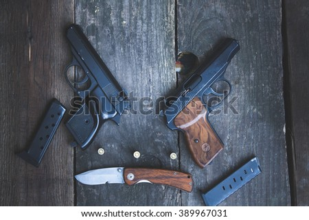 Various weapons against the backdrop of wooden planks
