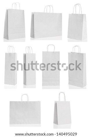 Various white paper shopping bags isolated
