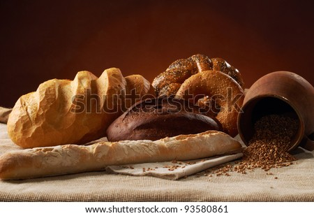 various whole baked bread with wheat on the tablecloth
