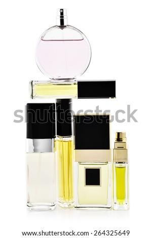 Various woman perfumes set isolated on white background. - stock photo