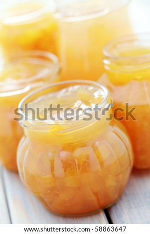 various yellow fruits jam in jars - food and drink - stock photo