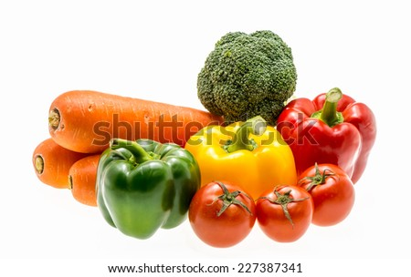 Varity of fresh vegetables on white background - stock photo