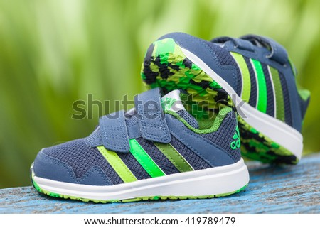 Varna , Bulgaria - APRIL 9, 2016 : ADIDAS SNICE 4 CF children shoe. Product shot. Adidas is a German corporation that manufactures sports shoes, clothing and accessories