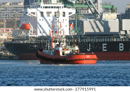 VARNA, BULGARIA - APRIL 04, 2015: Bulk carrier AFRICAN TEIST (IMO: 9655420) from Japan, Built: 2014, Flag: Panama, is unloading gas pipes at Port of Varna. - stock photo
