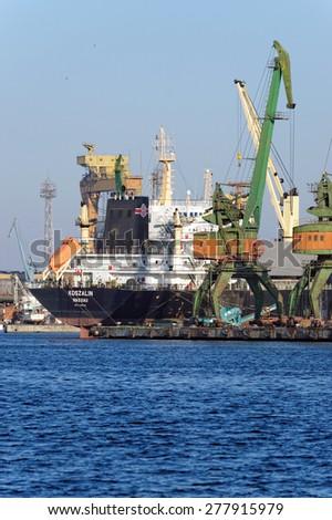 VARNA, BULGARIA - APRIL 04, 2015: Bulk carrier KOSZALIN (IMO: 9594236) from Poland, Built: 2012, Flag: Bahamas is loaded with 33000 t of wheat. - stock photo