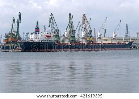 VARNA, BULGARIA - APRIL 24, 2016: Bulk Carrier SKIPPERS Y (Built: 1984, Flag:  Sierra Leone) is loaded with wheat in Port of Varna-East. - stock photo