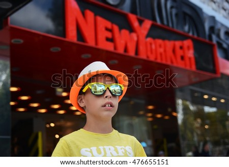 VARNA ,BULGARIA - AUGUST 27 : Young modern  boy against of NEW YORKER store on august 27 in Varna Bulgaria.