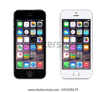 Varna, Bulgaria - December 08, 2013: Apple Space Gray and Silver iPhone 5S displaying iOS 8, mobile operating system, designed by Apple Inc. Isolated on white background. - stock photo