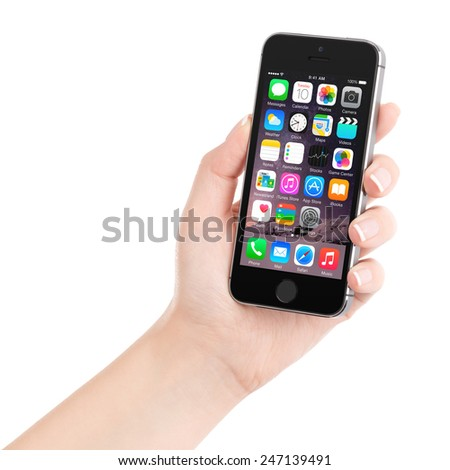 Varna, Bulgaria - December 07, 2013: Female hand holding Apple Space Gray iPhone 5S displaying iOS 8 mobile operating system, designed by Apple Inc. Isolated on white background. - stock photo