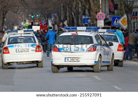 Varna, Bulgaria, FEB 22, 2015: Police car on duty in downtown Varna. Law enforcement services in Bulgaria are provided by several different departments of the Ministry of Interior affairs. - stock photo