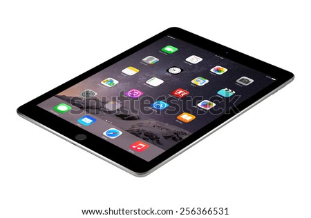 Varna, Bulgaria - February 04, 2014: Apple Space Gray iPad Air2 with touch ID displaying iOS 8 homescreen lies on the surface, designed by Apple. Isolated on white background. The whole image in focus - stock photo