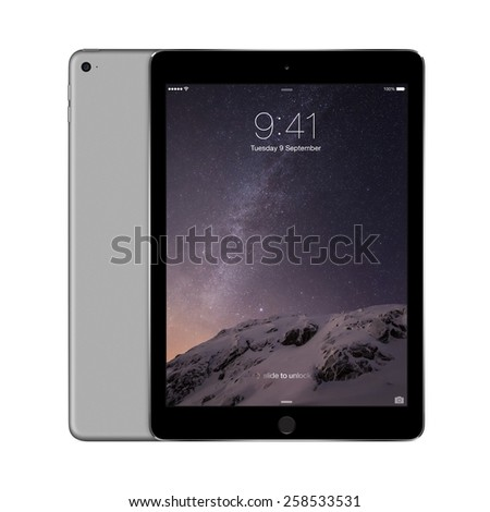 Varna, Bulgaria - February 02, 2014: Front and back sides of Apple Space Gray iPad Air 2 displaying iOS 8 with lock screen on the display, designed by Apple Inc. Isolated on white background. - stock photo