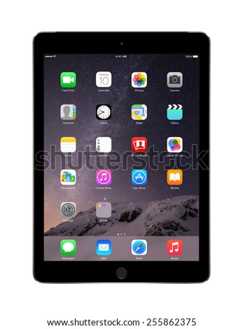 Varna, Bulgaria - February 02, 2014: Front view of Apple Space Gray iPad Air 2 with touch ID displaying iOS 8 homescreen, designed by Apple Inc. Isolated on white background. High quality. - stock photo