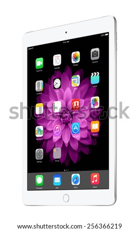 Varna, Bulgaria - February 02, 2014: Half turned Apple silver iPad Air 2 with touch ID displaying iOS 8 homescreen, designed by Apple Inc. Isolated on white background. The whole image in focus. - stock photo