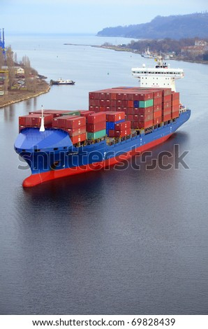 VARNA, BULGARIA - JANUARY 20: Cargo ship CALISTO (Flag: Liberia, IMO: 9306067) sails into Port of Varna-West to be loaded with containers on January 20, 2011 in Varna, Bulgaria. - stock photo