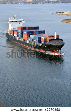 VARNA, BULGARIA - JANUARY 20: Cargo ship DS BLUE OCEAN (Flag: United Kingdom, IMO: 9341976) sails into open sea on January 20, 2011 in Varna, Bulgaria. Ship`s next destination is Island of Malta.