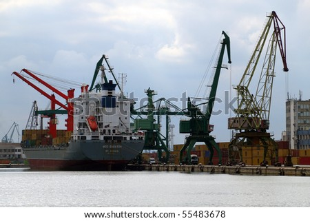 VARNA, BULGARIA - JUNE 17: Cargo ship MSC EQUATOR, IMO: 9004243 sailing under Antigua and Barbuda flag, moored in Port of Varna is unloading containers with goods on June 17, 2010 in Varna, Bulgaria.