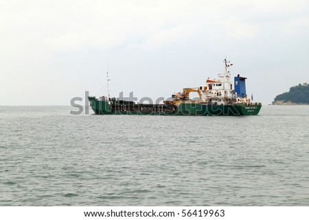 VARNA, BULGARIA - JUNE 25: Cargo ship PANAGIOTIS T (Year Built: 1983, DeadWeight: 2535 t, Flag: Greece) is sailing away after a short stay in Varna-west port on June 25, 2010 in Varna, Bulgaria. - stock photo