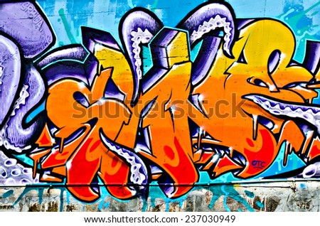 "VARNA, BULGARIA - JUNE 5, 2011: Fraction from the vast Eighty meters long graffiti painted on a concrete wall at Port of Varna as part of the ""Creatures from Black Sea"" Sprite Graffiti Jam 2011."