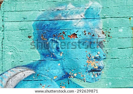 Varna, BULGARIA - June 21, 2015: Street art by unknown artist on a concrete wall close to Port of Varna. Close up of old man's face with visible paint cracks.  - stock photo