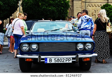 """VARNA, BULGARIA - JUNE 25: The annual Retro rally """"Old capitals"""" finished for the first time in town of Varna on June 25, 2011 in Varna, Bulgaria. View from the Jensen Interceptor  Convertible 1975 - stock photo"""