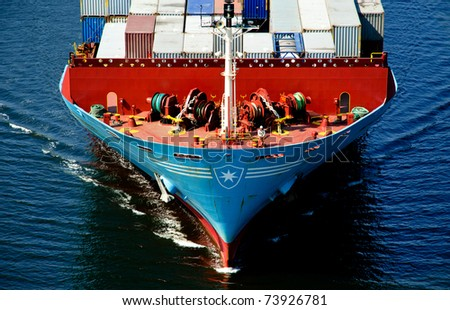 VARNA, BULGARIA-MAR 24: Cargo ship MAERSK TRAPANI (Year Built: 1990, Dead Weight: 21238 t) sails away into open sea after a short stay in Varna-west port on March 24, 2011 in Varna, Bulgaria - stock photo