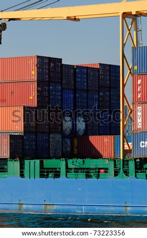 VARNA, BULGARIA - MARCH 14: Cargo ship HOLANDIA (Flag: Antigua Barbuda, Year Built: 2000) sails into Port of Varna-West to be loaded with containers on March 14, 2011 in Varna, Bulgaria. - stock photo