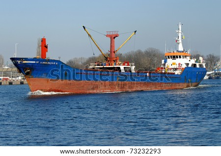 VARNA, BULGARIA - MARCH 14: Cargo ship OSMAN EKSIOGLU (Built: 1978, Flag: Turkey) sails towards Port of Varna-West to be loaded with goods on March 14, 2011 in Varna, Bulgaria.