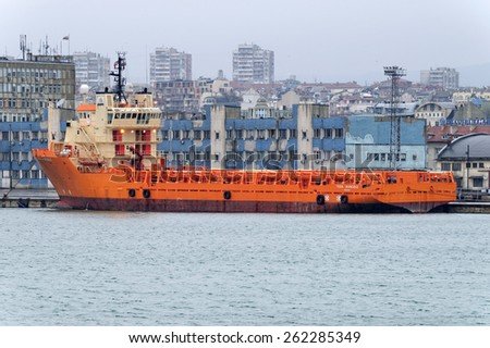 Varna, BULGARIA - March 7, 2015: Supply ship TOISA INVINCIBLE moored at Port of Varna-East. The vessel will take part in the construction of gas pipeline from Russia to Europe.