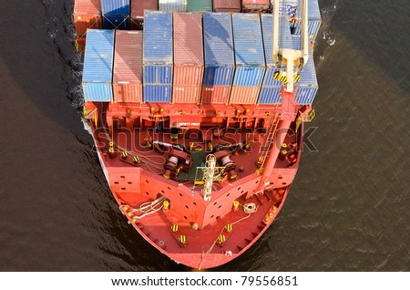 VARNA, BULGARIA - MAY 13: Cargo ship ALEXANDER SIBUM (Flag: Antigua Barbuda, Year Built: 2006) sails to Port of Varna-West to load containers on May 13, 2011 in Varna, Bulgaria.