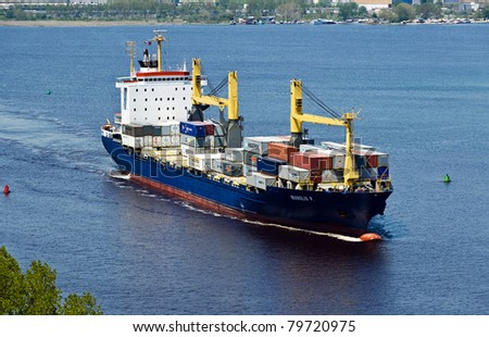 VARNA, BULGARIA - MAY 15: Cargo ship MANOLIS P (Flag: Marshall Is, DeadWeight: 20346 t, IMO: 9101493) sails into open sea after a short stay in Varna-west port on May 15, 2011 in Varna, Bulgaria. - stock photo