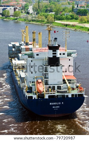 VARNA, BULGARIA - MAY 15: Cargo ship MANOLIS P (Flag: Marshall Is, DeadWeight: 20346 t, IMO: 9101493) sails into open sea after a short stay in Varna-west port on May 15, 2011 in Varna, Bulgaria.