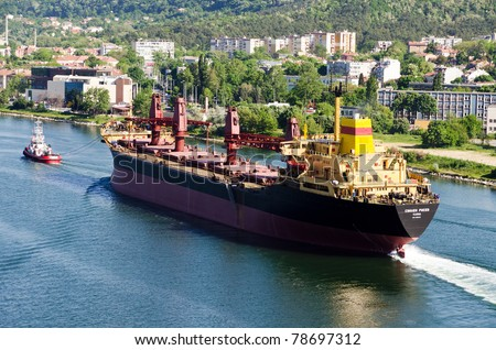 VARNA, BULGARIA - MAY 28: Cargo ship SVILEN RUSSEV (Year Built: 1982, Flag: Bulgaria, DeadWeight: 39408 ton) sails away into open sea after a major revamp work on May 28, 2011 in Varna, Bulgaria - stock photo